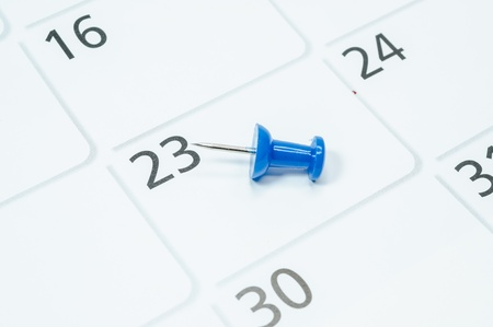 Blue pins mark the 23th on your calendar. Stock Photo