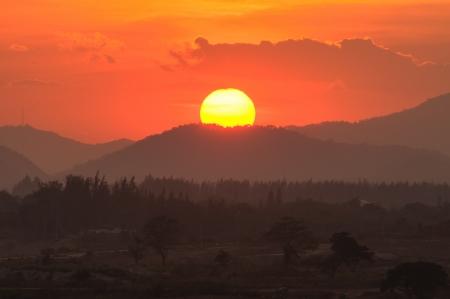 The Orange sunset evening on the mountain.