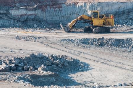 Yellow excavator loader lignite. Work in the mine. Stock Photo - 17358612