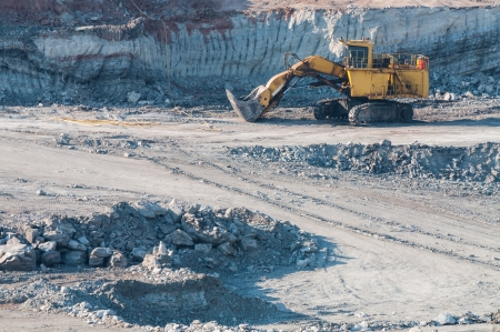 open trench: Yellow excavator loader lignite. Work in the mine.