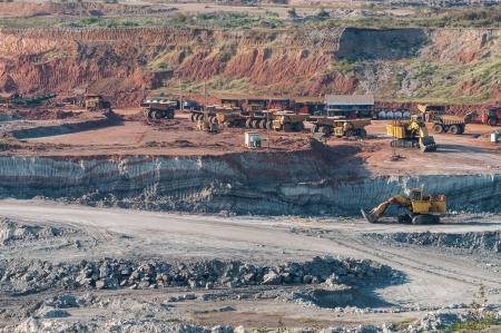 Yellow excavator loader lignite. Work in the mine.