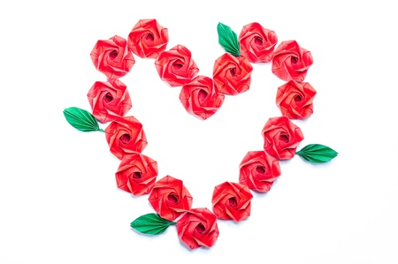 Red roses and heart shaped. Recycled paper craft fold. Stock Photo - 17358502