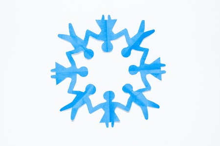 Blue Paper people holding hands in a circle of men and women. Paper reuse, Paper craft and origami. photo