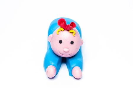 Baby blue plasticine crafts on a white background. photo