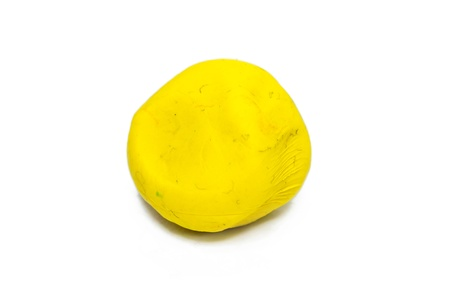 Colorful plasticine. Yellow on a white background. Stock Photo