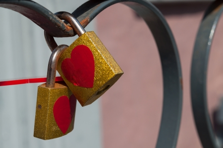 A lock with a heart shaped sticker with red lace. Stock Photo - 19281255