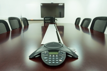 Conference room phone. The board and a TV in the meeting room.