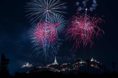Brightly colorful fireworks and salute of various colors in the night sky.