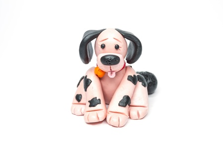 streaked: Dog sculpture with clay streaked with black dots. Stock Photo