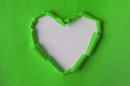 Recycled paper green. Torn heart. Paper crafts. Stock Photo