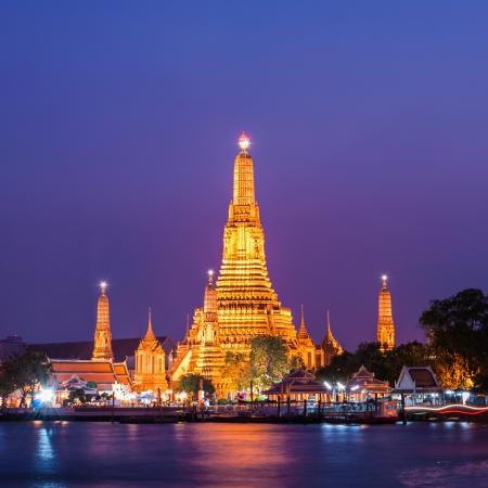 Twilight view of Wat Arun across Chao Phraya River during sunset in Bangkok, Thailand photo