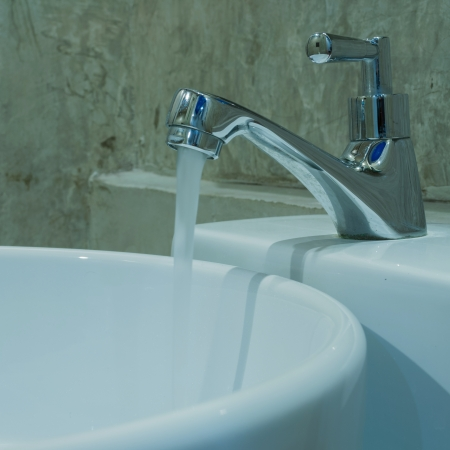 Circular basin. Modern design. Elegant and faucets. photo