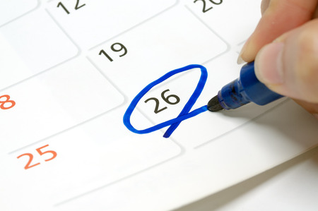 Calendars are drawn circle at 26 with a blue pen.