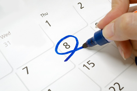 Calendars are drawn circle at 8 with a blue pen.