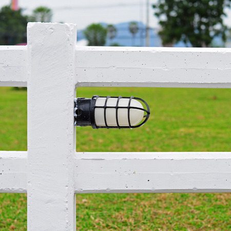 affixed: White lights affixed to the white fence. Stock Photo