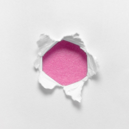 Torn white paper in a circle Inside the pink circle. photo