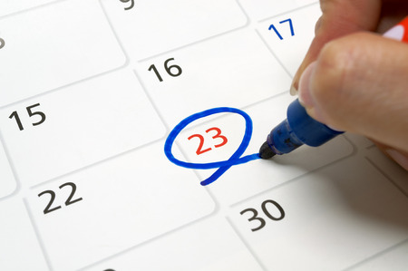 Calendars are drawn circle at 23 with a blue pen.