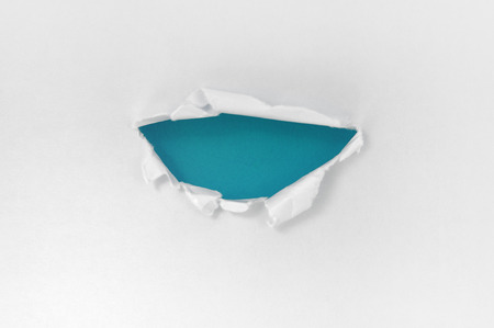 White paper torn semicircle shape beautiful. Beautiful blue background photo