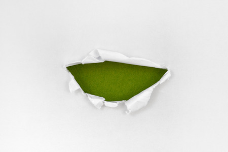 White paper torn semicircle shape beautiful. Beautiful green background photo
