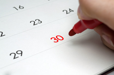 Calendars are red color at 30 and red pen.