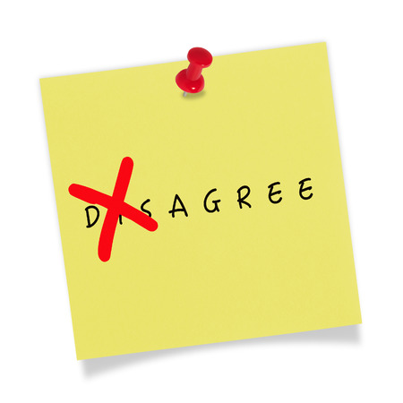 disagree: Yellow paper with red pin on white background. Changing the word disagree to Agree. Stock Photo