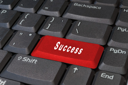 Computer red keyboard button, write the word success white. Stock Photo