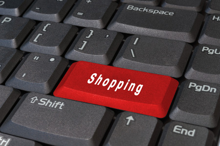Computer red keyboard button, write the word shopping white. photo