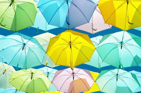 Umbrella yellow, blue, pink, green, hanging beautifully adorned. Stock Photo