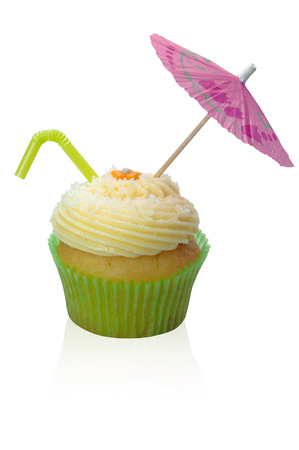 Coconut cupcake with a pink umbrella and Green Tube coconut Water on a white background.