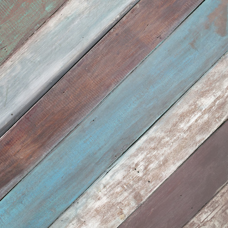 Old brown wooden background with green and blue stripes.
