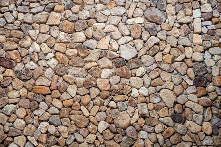 Texture of the stone wall from many different size of rock