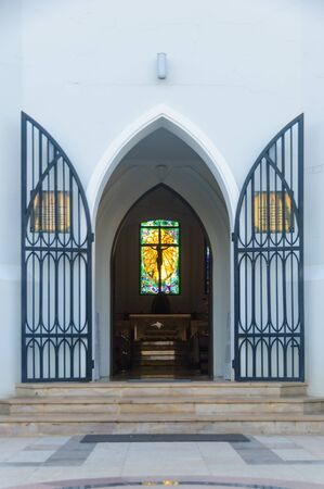 Country church door welcome open showing Silhouette jesus christ on cross inside. Imagens