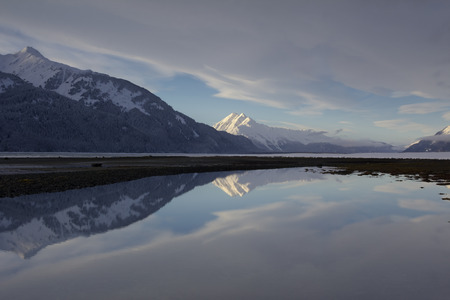 Calm Mountain Reflection on Remote Alaska Beach