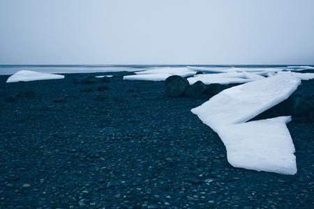 Ice on Distant Alaska Shore Revealed at Low Tide