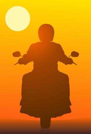 赤い夕日に対してモーターサイク リスト