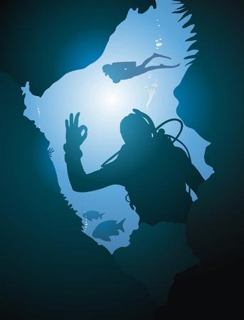 Duikers zwemmen in de oceaan tussen de reeves