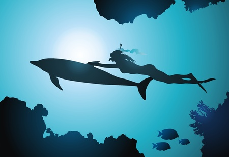 among: The girl-diver floats together with a dolphin among reeves