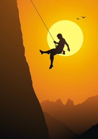mountain climber: The climber goes down from the rock on a rope