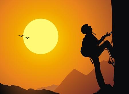 De rock-klimmer stijgt op de rots aan een touw