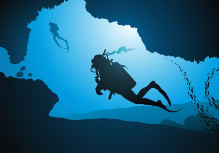 man underwater: Divers float among corals and fishes
