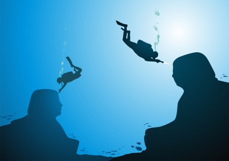 man underwater: Divers swim about the sunk sphinxes against the sun