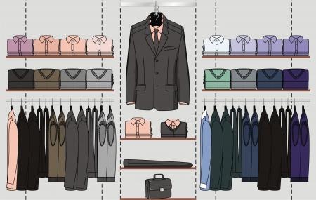 I vestiti per gli uomini sono impiccati da display negozio