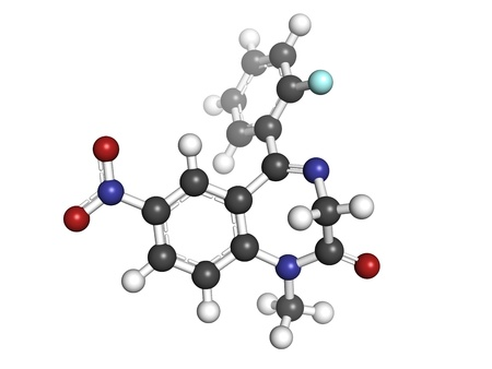 benzodiazepine: flunitrazepam benzodiazepine drug, molecular model. Atoms are represented as spheres with conventional color coding: hydrogen (white), carbon (grey), oxygen (red), nitrogen (blue), fluorine (gold) Stock Photo