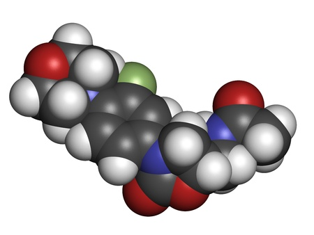 bacteriostatic: Linezolid antibiotic drug (oxazolidinone class), chemical structure. Atoms are represented as spheres with conventional color coding: hydrogen (white), carbon (grey), nitrogen (blue), oxygen (red), fluorine (green). Stock Photo
