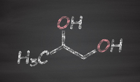 acidosis: Propylene glycol (1,2-propanediol) molecule. Used as solvent in pharmaceutical drugs, as food additive, in de-icing solutions, etc. Chalk on blackboard style illustration.