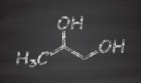 Propylene glycol (1,2-propanediol) molecule. Used as solvent in pharmaceutical drugs, as food additive, in de-icing solutions, etc. Chalk on blackboard style illustration.