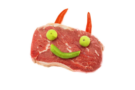 Smiling marbled beef with horns and eyes on white backgroung photo