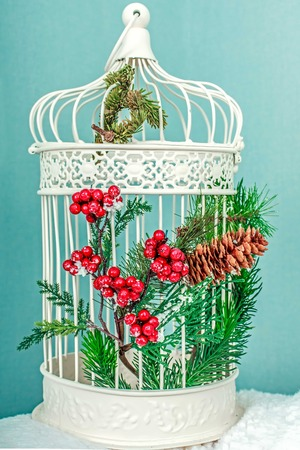 White christmas cage with tree decoration photo