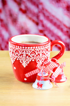 Cup of hot cocao with two christmas bells photo