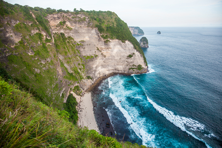 This is Kelingking Beach on the island of Nusa Penida near the island of Bali in Indonesia